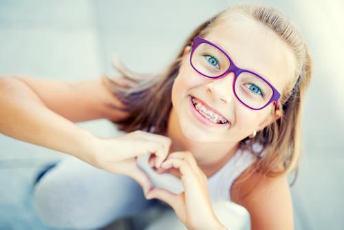 Исправление прикуса: детские зубные пластины и брекеты